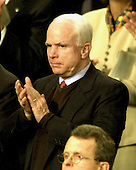 Washington, DC - January 28, 2003 -- United States Senator John McCain (Republican of Arizona) applauds as United States President George W. Bush delivers his State of the Union Address to a Joint Session of the United States Congress.<br /> Credit: Ron Sachs / CNP
