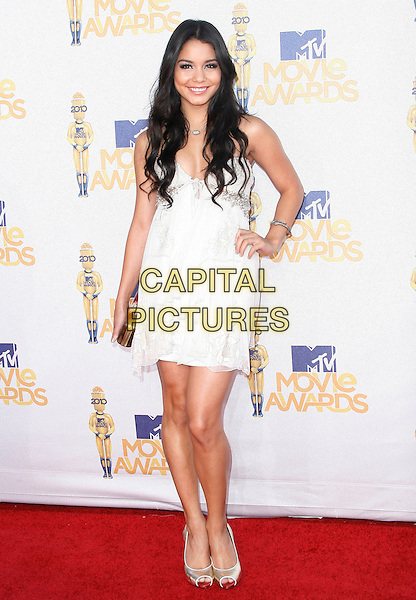 VANESSA HUDGENS .arriving at the 2010 MTV Movie Awards held at Gibson Amphitheatre at Universal Studios Universal City, California, USA, June 6th, 2010..arrivals full length white dress hand on hip cream gold peep toe shoes .CAP/ROT/MC.©Max Cash / Roth Stock/Capital Pictures