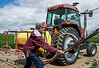 Farmer Matt Heimerich, one of only a few remaining farmers in Cowley County, sprays pesticide on his alfalfa crops near the town of Crowley, Colorado, Wednesday, May 18, 2016. When most farmers sold their water rights in the 1980s, Heimerich and his family held on to their's. As a result, they are still able to irrigate their farm land. Crowley County, once a thriving agricultural community with over 50,000 acres of farm land, sold it's water rights the City of Aurora for municipal use and now farms a little more than 5,000 acres of land. The result has seen dried and dead farm land and abandoned homesteads. Crowley County represents a dire look at how mismanaged water rights can have devastating effects on an already drought prone region.<br /> <br /> Photo by Matt Nager