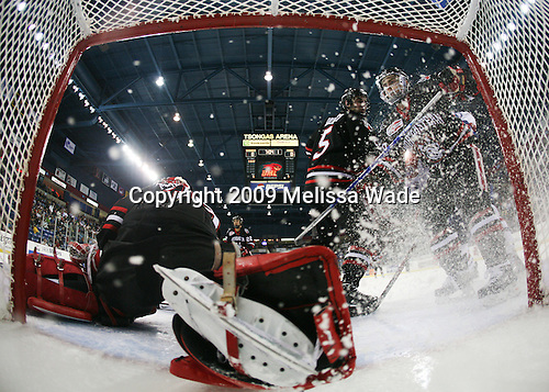 Brad Thiessen (Northeastern - 39), Louis Liotti (Northeastern - 5), Mike Hewkin (Northeastern - 28) - The Northeastern University Huskies defeated the University of Massachusetts-Lowell Riverhawks 3-1 on Saturday, February 28, 2009, at the Paul E. Tsongas Arena in Lowell, Massachusetts.