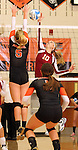 SIOUX FALLS, SD - OCTOBER 1:  Paige Rome #10 from Roosevelt looks to get a kill past Lauren Farritor #5 from Washington in the second game of their match Tuesday night at Washington. (Photo by Dave Eggen/Inertia)
