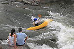 Couple watching a kayaker in whitewater, Denver, Colorado, USA.