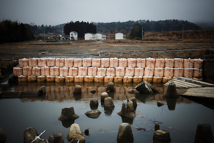 Hirono, February 23 2012 - Dam made of sand bags on the coast of Hirono, on the border of nuclear exclusion zone.