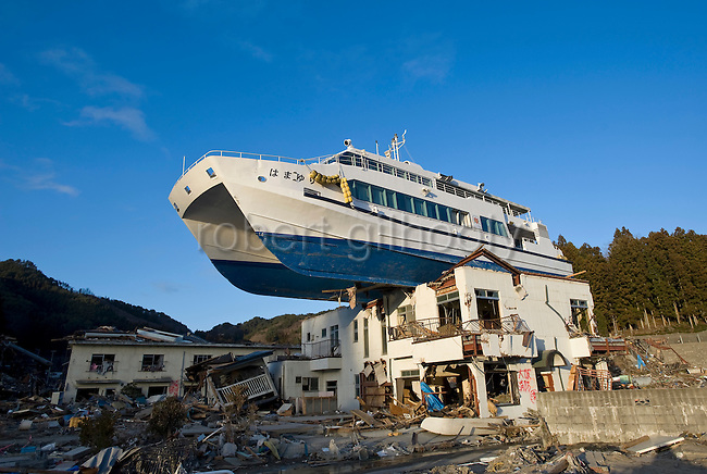 A boat sits atop a building in Otsuchi, Iwate Prefecture, Japan on 04 April, 2011. .Photographer: Robert Gilhooly