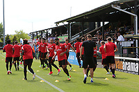Watford's Development Squad warm up pre-match. Admission prices were reduced after Watford announced they would be fielding their youngsters rather than the first team during Woking vs Watford, Friendly Match Football at The Laithwaite Community Stadium on 8th July 2017
