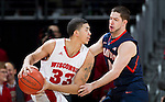 Illinois Fighting Illini guard Sam Maniscalco (0) defends against Wisconsin Badgers forward Rob Wilson (33) during a Big Ten Conference NCAA college basketball game on Sunday, March 4, 2012 in Madison, Wisconsin. The Badgers won 70-56. (Photo by David Stluka)