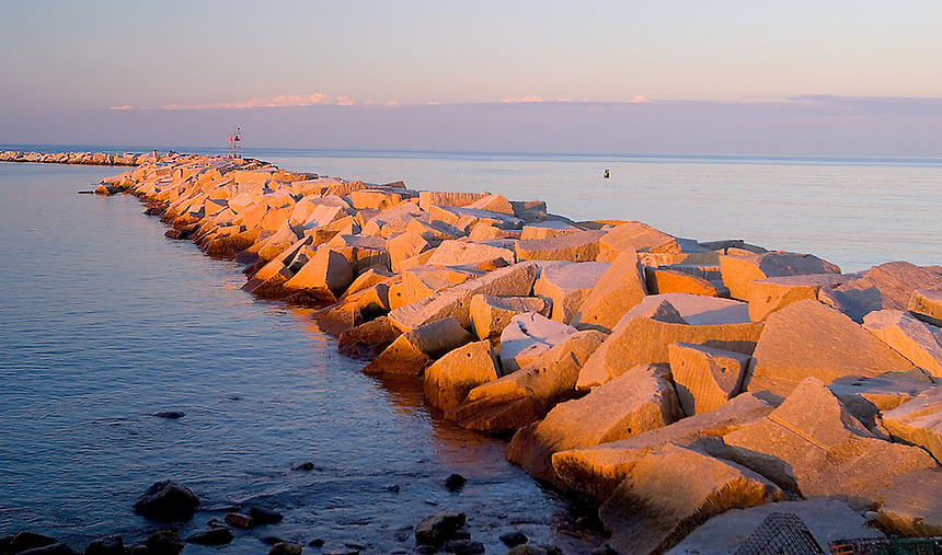 Sunset light on the south jetty, Rye Harbor, New Hampshire. Photograph by Peter E. Randall