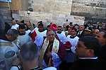 """The Latin Patriarch of Jerusalem Fuad Twal (C), the head of the Roman Catholic Church in the Holy Land, takes part in the Christmas celebrations outside the Church of the Nativity in the West Bank city of Bethlehem, on December 24, 2013. Thousands of Palestinians and tourists flocked into the West Bank city of Bethlehem to mark Christmas in the """"little town"""" where many believe Jesus Christ was born. Photo by Issam Rimawi"""