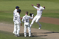 Simon Harmer of Essex celebrates with his team mates after taking the wicket of Tom Bailey during Lancashire CCC vs Essex CCC, Specsavers County Championship Division 1 Cricket at Emirates Old Trafford on 11th June 2018