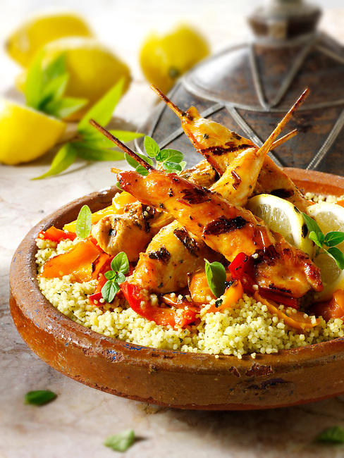 Couscous with Mediterranean roast vegetables and chicken kebabs