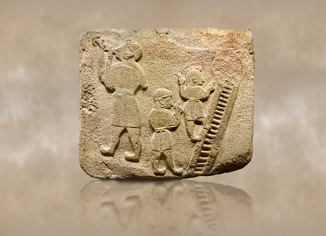 Landscape picture of Alaca Hoyuk Sphinx Gate Hittite monumental relief sculpted orthostat stone panel. Andesite, Alaca, Corum, 1399 - 1301 B.C. Jugglers and acrobats.  Anatolian Civilizations Museum, Ankara, Turkey<br /> <br /> The juggler facing towards left, with long hair and a short dress, swallows a dagger; the smaller acrobats behind go up the stairs without holding on. All the figures have horned headdresses and earrings with a huge ring on their ears. It is thought that the acrobats are of different nationality, which is the reason why they are depicted smaller. <br /> <br /> Against a brown art background.