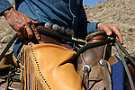 Cowboy and saddle on horse