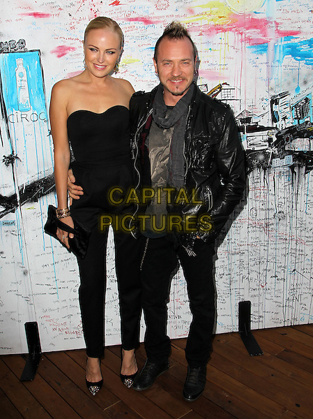 Malin Akerman & Roberto Zincone.Ciroc Cabana Club Kickoff Memorial Day Party Held at The Sky Bar at the Mondrian Hotel, West Hollywood, California, USA..May 26th, 2012.full length black strapless jumpsuit clutch bag jeans denim leather jacket married husband wife .CAP/ADM/KB.©Kevan Brooks/AdMedia/Capital Pictures.