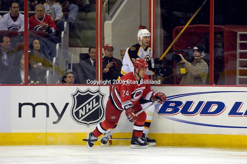 Carolina Hurricane's Scott Walker (24) is dwarfed by the Boston Bruins' Zdeno Chara during an NHL hockey game Saturday, Dec. 2, 2006 in Raleigh, N.C. Carolina won 5-2.<br />