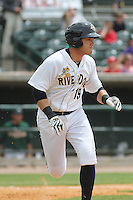Charleston Riverdogs third baseman Dante Bichette, Jr. #19 running to first base during a game against the Savannah Sand Gnats at Joseph P. Riley Jr. Park on May 16, 2012 in Charleston, South Carolina. Charleston defeated Savannah by the score of 14-5. (Robert Gurganus/Four Seam Images)