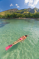 A woman snorkeling at Olowalu, Maui.
