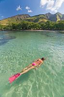 A woman snorkeling at Olowalu, Maui.