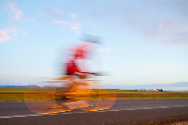 Blurred cyclist, Boulder, Colorado, .  John leads private photo tours in Boulder and throughout Colorado. Year-round.