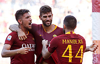 Roma's Federico Fazio, center, celebrates with his teammates Lorenzo Pellegrini, left, and Kostas Manolas after scoring during the Italian Serie A football match between Roma and Lazio at Rome's Olympic stadium, September 29, 2018. Roma won 3-1.<br /> UPDATE IMAGES PRESS/Riccardo De Luca