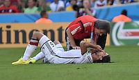 FUSSBALL WM 2014                VIERTELFINALE Frankreich - Deutschland           04.07.2014 Sami Khedira (am Boden) laesst sich von Hans-Wilhelm Müller-Wohlfahrt behandeln