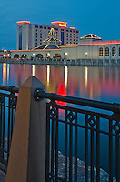 Harrah's Casino in Joliet, Illinois sits on the bank of the DesPlaines River as seen from Bicentennial Park on the opposite river bank at Dusk