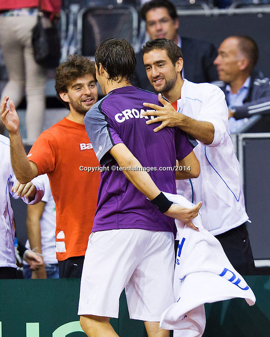 September 12, 2014, Netherlands, Amsterdam, Ziggo Dome, Davis Cup Netherlands-Croatia, Mate Delic (CRO) jubilates his win over Sijsling, and is congratulated bin his team members Cilic (R)<br /> Photo: Tennisimages/Henk Koster