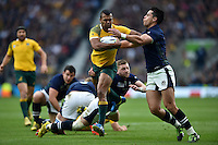 Kurtley Beale of Australia takes on the Scotland defence. Rugby World Cup Quarter Final between Australia and Scotland on October 18, 2015 at Twickenham Stadium in London, England. Photo by: Patrick Khachfe / Onside Images