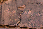 Ancient rock art depicting a camel caravan in Khaz'ali Canyon in the Wadi Rum Protected Area, a UNESCO World Heritage Site.  The petroglyphs are of Thamudic origin and are more than 2000 years old.  Also shown are some Arabian or Nubian ibex.