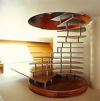Access to the upper floor of the house is by way of this dramatic spiral staircase