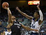 San Diego State forward Matt Mitchell (11) is fouled by Nevada forward Jordan Brown (21) in the first half of an NCAA college basketball game in Reno, Nev., Saturday, Mar. 9, 2019. (AP Photo/Tom R. Smedes)