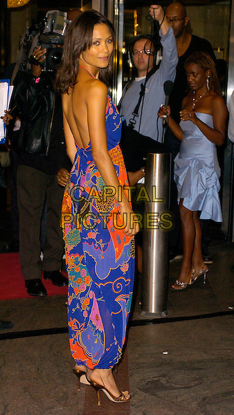 THANDIE NEWTON.At the Screen Nation Film & TV Awards, .Hilton Park Lane Hotel, London, England, .October 10th 2006..full length red and blue print dress pattern  halterneck back behind shoulder .Ref: CAN.www.capitalpictures.com.sales@capitalpictures.com.©Can Nguyen/Capital Pictures