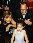 "Mariska Hargitay and Christopher Meloni, stars of the NBC series ""Law and Order: Special Victims Unit"",  pose for a photo with Kaitlyn Glassmacher, 15, of Fairfax, Virginia at the 2003 White House Correspondents Dinner at the Washington Hilton Hotel in Washington, D.C. on April 26, 2003. Kaitlyn suffers from Glassmacher Syndrome, a disease that resembles Multiple Sclarosis..Credit: Ron Sachs / CNP"