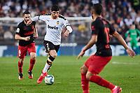 14th February 2020; Mestalla, Valencia, Spain; La Liga Football,Valencia versus Atletico Madrid; Guedes of Valencia CF challenged by Koke and Renan Lodi of Atletico Madrid