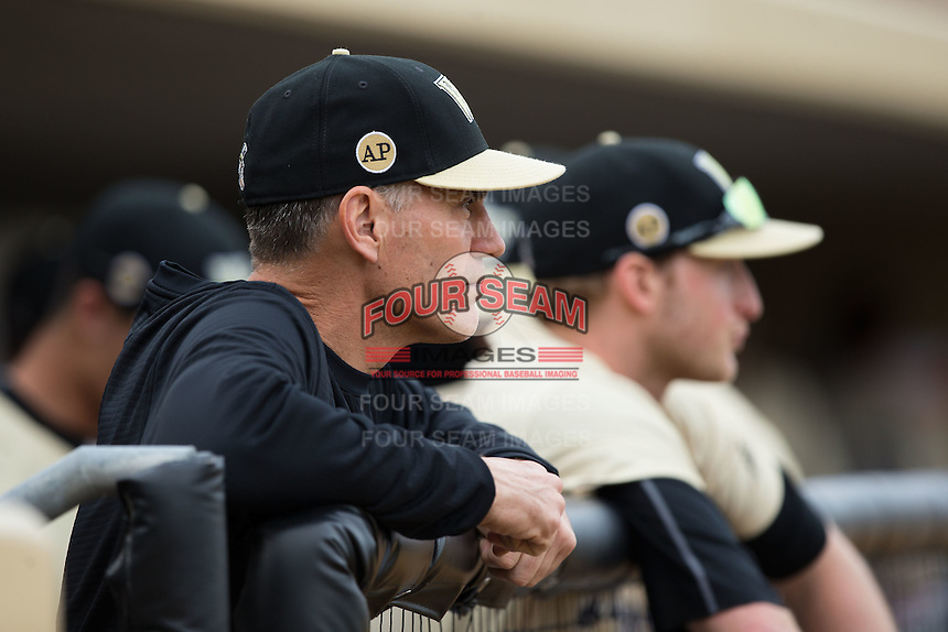 Wake Forest Demon Deacons head coach Tom Walter (16) watches the UNCG Spartans take infield practice at David F. Couch Ballpark on February 21, 2017 in  Winston-Salem, North Carolina.  The Demon Deacons defeated the Spartans 15-8.  (Brian Westerholt/Four Seam Images)