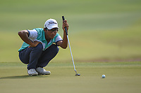 Kartik SHARMA (IND) lines up his putt on 5 during Rd 3 of the Asia-Pacific Amateur Championship, Sentosa Golf Club, Singapore. 10/6/2018.<br /> Picture: Golffile | Ken Murray<br /> <br /> <br /> All photo usage must carry mandatory copyright credit (© Golffile | Ken Murray)