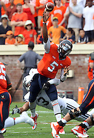 Virginia quarterback David Watford (5) handles the ball during the first half of the game in Charlottesville, Va. Virginia defeated Brigham Young 19-16. Photo/Andrew Shurtleff