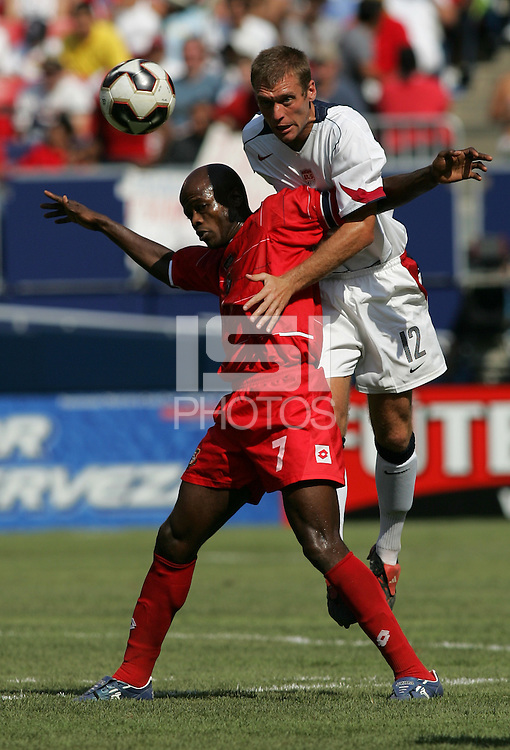 July 24, 2005: East Rutherford, NJ, USA:  USMNT defender Jimmy Conrad (12) goes over the back of Panama's Jorge Luis Dely Valdes (7) during the CONCACAF Gold Cup Finals at Giants Stadium.