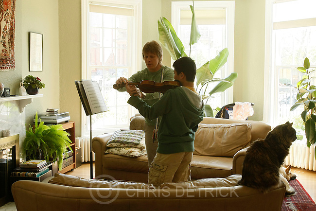 David Porter teaches violin lessons to Eric Cheung, 14, at his home in Salt Lake City May 9, 2009. Porter is a violinist with the Utah Symphony who, along with dozens of other musicians, agreed to pay and benefit cuts because of the market collapse's effect on the symphony.. .Chris Detrick/The Salt Lake Tribune