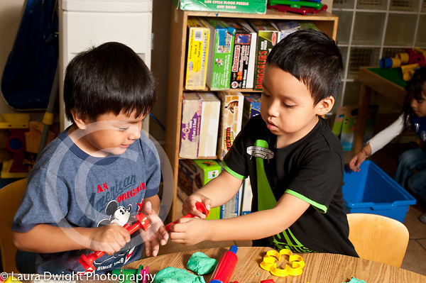 Education preschool 3-4 year olds two boys playing together art activity play dough
