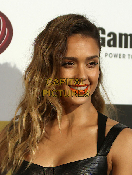 Jessica Alba.Spike TV's 10th Annual Video Game Awardse Held at Sony Pictures Studios,  Culver City, California, USA, .7th December 2012..portrait headshot  red orange lipstick make-up  beauty eyelashes wavy hair black  leather smiling .CAP/ADM/KB.©Kevan Brooks/AdMedia/Capital Pictures.