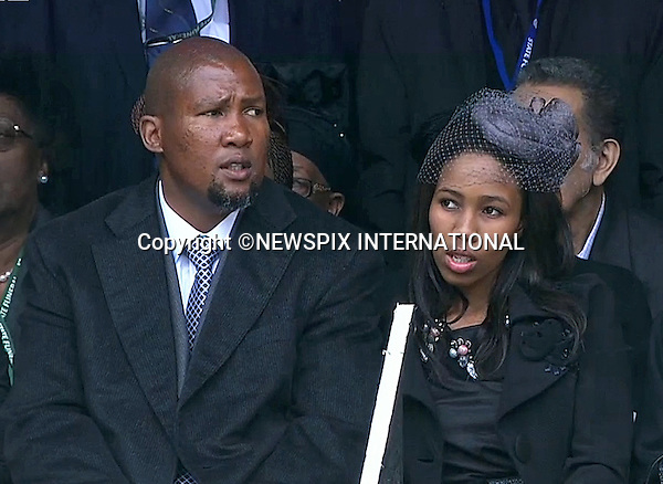 MANDELA FAMILY MEMBERS INCLUDING GRANDSON MANDLA MANDELA (beard)<br /> NELSON MANDELA MEMORIAL<br /> The nation mourns Nelson Rolihlahla Mandela Memorial Service, FNB Stadium, Johannesburg, South Africa<br /> Mandatory Credit Photo: &copy;NEWSPIX INTERNATIONAL<br /> <br /> **ALL FEES PAYABLE TO: &quot;NEWSPIX INTERNATIONAL&quot;**<br /> <br /> IMMEDIATE CONFIRMATION OF USAGE REQUIRED:<br /> Newspix International, 31 Chinnery Hill, Bishop's Stortford, ENGLAND CM23 3PS<br /> Tel:+441279 324672  ; Fax: +441279656877<br /> Mobile:  07775681153<br /> e-mail: info@newspixinternational.co.uk