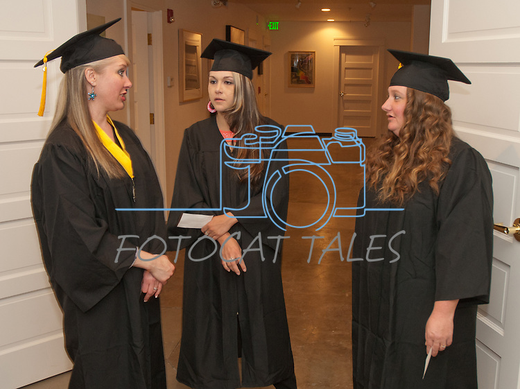 Shannon Ross, Shiloh Howell and Micki Foss talk about future plans at the Western Nevada College commencement in Fallon, Nev., on Tuesday, May 20, 2014. <br /> Photo by Kim Lamb