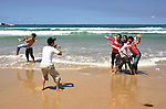Chinese tourists take happy snaps in the surf and sun on sydney's iconic Bondi Beach.  25th October 2004. Photo: (Steve Christo)
