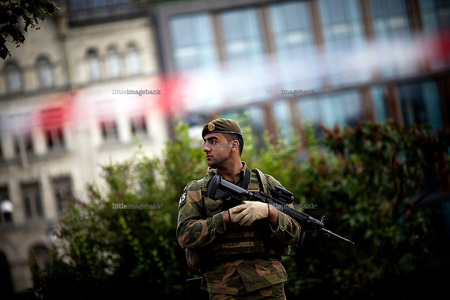 Oslo, Norway, 23.07.2011. Army rangers guards the parlament. Oslo awakes to shocking messages of the total bodycount after yesterdays massacre. A total of 91 persons were killed in the massacre in Utøya right outside Oslo. Seven of those died when a car bomb was detonated outside the main government biuilding in the heart of Oslo, friday 22. of July. Foto: Christopher Olssøn.