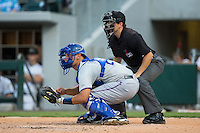 Durham Bulls catcher Luke Maile (26) sets a target as home plate umpire Jansen Visconti looks on during the game against the Charlotte Knights at BB&T BallPark on July 22, 2015 in Charlotte, North Carolina.  The Knights defeated the Bulls 6-4.  (Brian Westerholt/Four Seam Images)