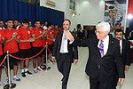 Palestinian President Mahmoud Abbas greets the Palestinian national football team which won the AFC Challenge Cup, at Abbas's office in the West Bank city of Ramallah on June 1, 2014. Palestine qualified for their maiden Asian Cup appearance with a 1-0 win over injury-hit Philippines in the final of the AFC Challenge Cup in Maldives. Photo by Thaer Ganaim