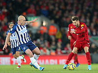 30th November 2019; Anfield, Liverpool, Merseyside, England; English Premier League Football, Liverpool versus Brighton and Hove Albion; Adam Lallana of Liverpool controls the ball challenged by Adrian Mooy of Brighton and Hove Albion - Strictly Editorial Use Only. No use with unauthorized audio, video, data, fixture lists, club/league logos or 'live' services. Online in-match use limited to 120 images, no video emulation. No use in betting, games or single club/league/player publications