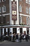 The Gun public house with Friday evening drinkers on the street Brushfield Street, Spitalfields, London E1, England