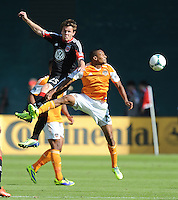 Ricardo Clark (13) of the Houston Dynamo goes against Jared Jeffrey (25) of D.C. United. The Houston Dynamo defeated D.C. United 2-1, at RFK Stadium, Saturday October 27, 2013.