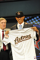 "Shortstop Carlos Correa (Puerto Rico Baseball Academy) the number one overall pick to the Houston Astros with MLB Commissioner Allen ""Bud"" Selig during the MLB Draft on Monday June 04,2012 at Studio 42 in Secaucus, NJ. Photo By Tomasso DeRosa/ Four Seam Images"